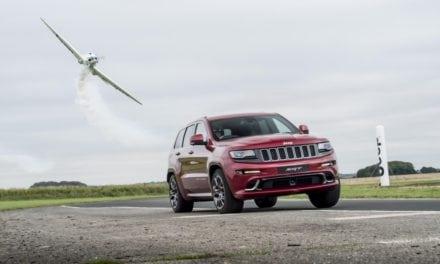 Jeep Grand Cherokee SRT races aerobatic twister plane in ultimate hot lap