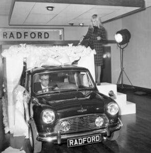Britt Elkland Peter Sellers Radford Mini copy 296x300 - Radford Returns with Motoring Legends